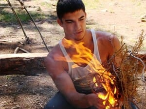Survival School Texas. Student learning to make fire.