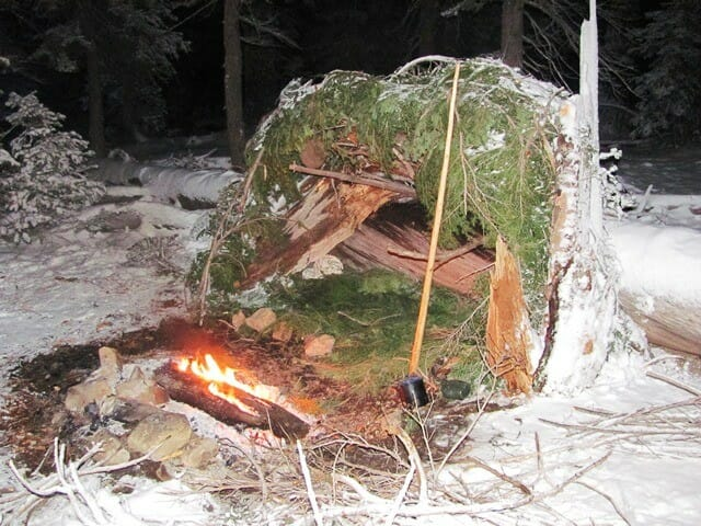 Lean-to shelter uses a warming fire to heat
