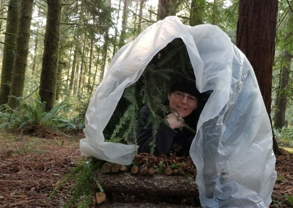 Survival Emergency Shelter Oregon. Student testing survival shelter